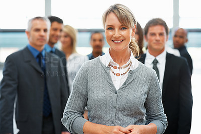 Buy stock photo Businesswoman taking lead with colleagues in background