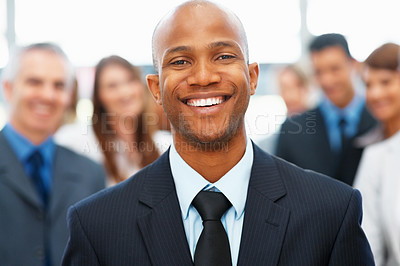 Buy stock photo Closeup of handsome businessman with colleagues in background