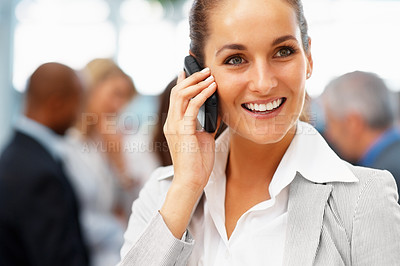 Buy stock photo Businesswoman having a phone conversation with people in background