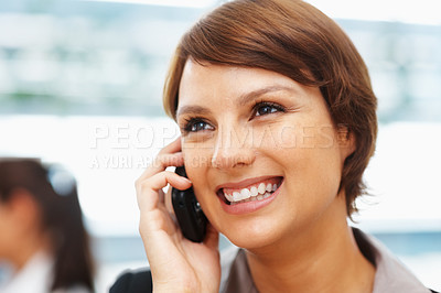 Buy stock photo Closeup of smiling young executive using cell phone
