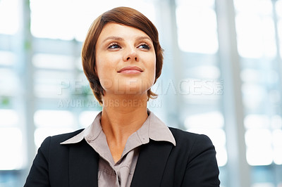 Buy stock photo Young executive looking off into distance