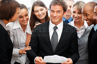 Buy stock photo Colleagues looking at executives expression while he holds report