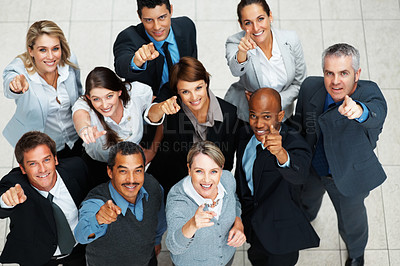 Buy stock photo Top view of executives smiling and pointing