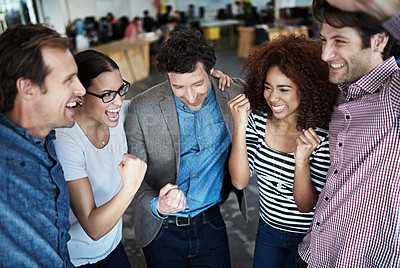 Buy stock photo Shot of a group of coworkers celebrating together in an office