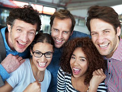 Buy stock photo Portrait of a group of ecstatic colleagues in an office