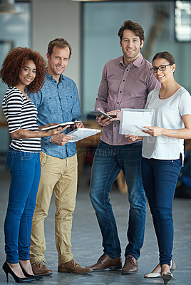 Buy stock photo Shot of a group of coworkers standing in an office talking