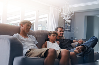 Buy stock photo Cropped shot of a father and his two young sons relaxing together at home