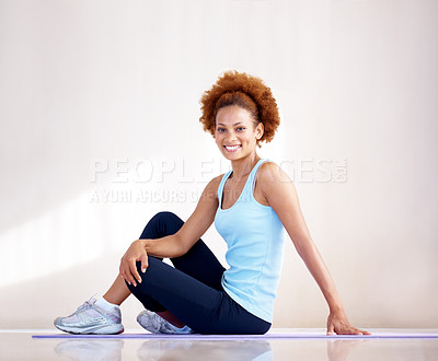 Buy stock photo Portrait of a happy young fitness woman exercising on yoga mat - Indoor