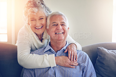 Buy stock photo Portrait of a senior couple relaxing at home