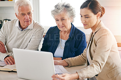 Buy stock photo Cropped shot of a senior couple getting advice from their financial consultant