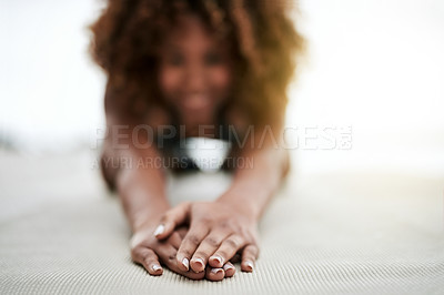Buy stock photo Portrait of a happy young woman doing yoga by herself at home