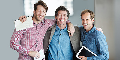 Buy stock photo Portrait of a group of laughing coworkers standing arm in arm together in an office