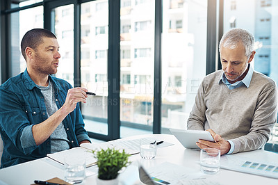 Buy stock photo Shot two businessmen having a meeting in a modern office