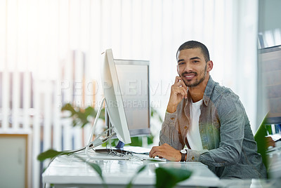 Buy stock photo Portrait of a smiling young designer working on a computer in a modern office