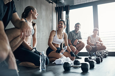 Buy stock photo Shot of a fitness group having a workout session at the gym