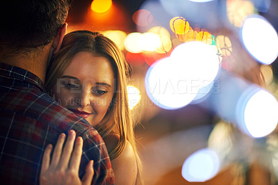 Buy stock photo Shot of a young couple out on a date in the city