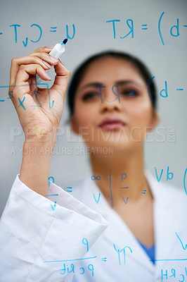 Buy stock photo Cropped shot of an attractive young female scientist working on a glass wall in her lab