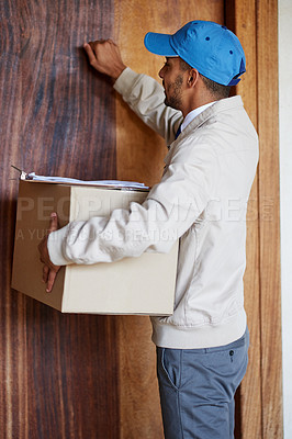 Buy stock photo Shot of a delivery man delivering a box to a customer's door