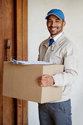 Buy stock photo Portrait of a friendly delivery man delivering a box to a customer's door