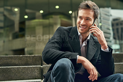 Buy stock photo Cropped shot of a young businessman talking on a cellphone outside
