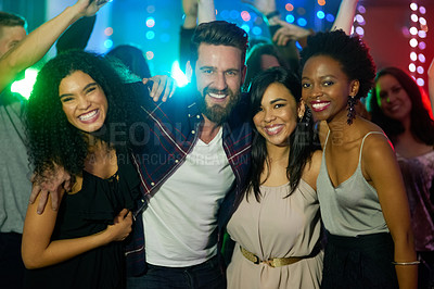 Buy stock photo Portrait of a group of smiling friends enjoying an eveing in a nightclub