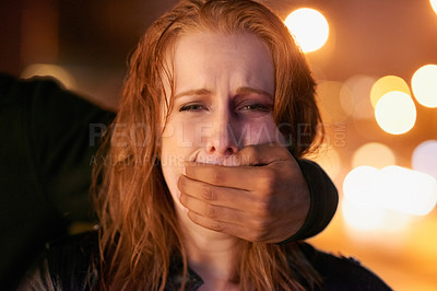 Buy stock photo Portrait of a frightened young woman being grabbed by a criminal in the city