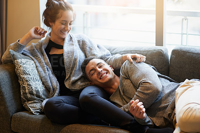 Buy stock photo Portrait of a handsome young man lying on his girlfriend's lap on the sofa