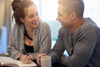 Buy stock photo Shot of a happy young couple relaxing at home