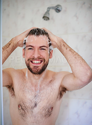 Buy stock photo Cropped shot of a handsome young man having a shower at home