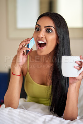 Buy stock photo Shot of a young woman talking on the phone in bed and looking surprised