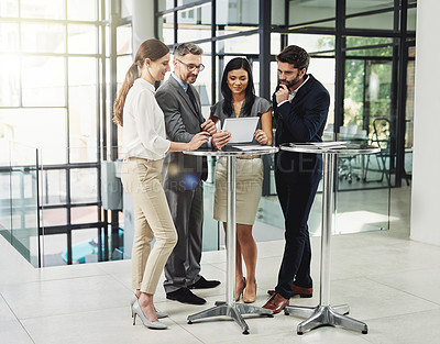 Buy stock photo Shot of a group of colleagues discussing business in the office