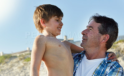 Buy stock photo Cropped shot of a father and son bonding together at the beach