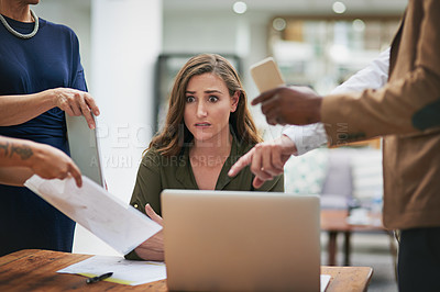 Buy stock photo Shot of a young businesswoman looking anxious in a demanding office environment
