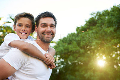 Buy stock photo Cropped shot of an affectionate young father and his son