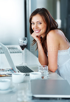 Buy stock photo Portrait of a pretty young woman standing in kitchen with laptop at home - Indoor
