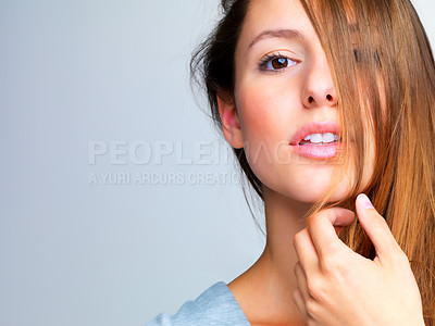 Buy stock photo Closeup portrait of a lovely young girl posing against grey background