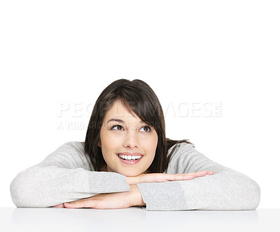 Buy stock photo Portrait of a cute young female sitting relaxed at a table and looking at copyspace