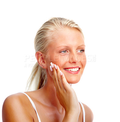 Buy stock photo Image of a cute young woman touching her face , smiling over white background
