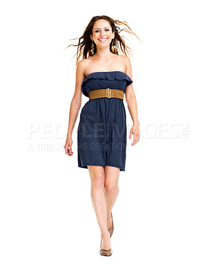 Buy stock photo Portrait of a smiling young woman walking on white background