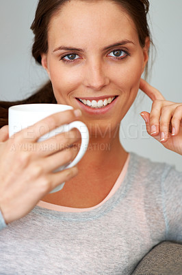 Buy stock photo Charming young girl having a cup of coffee