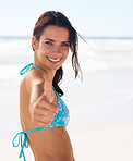 Thumbs up: An attractive woman showing a gesture at the beach