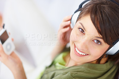 Buy stock photo Happy woman enjoying music on an mp3 player