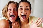 Closeup of an excited young women screaming together