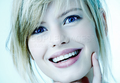 Buy stock photo Portrait of a beautiful happy young woman. With a cool blue tint.