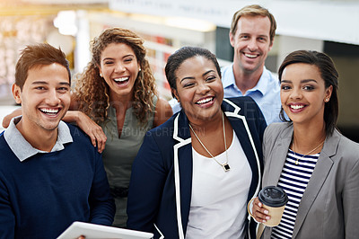 Buy stock photo Portrait of a group of smiling coworkers standing in an office