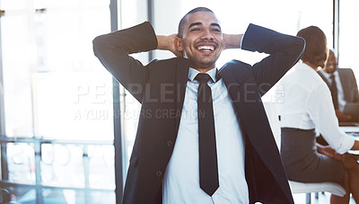 Buy stock photo Shot of a happy young businessman relaxing during a meeting at work