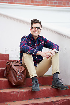 Buy stock photo Portrait of a handsome young man sitting on some steps outside
