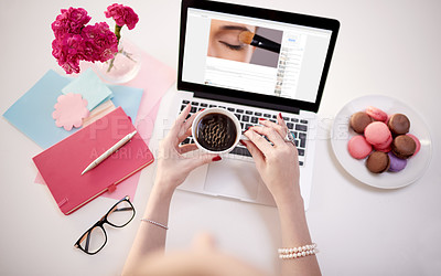 Buy stock photo High angle shot of an unidentifiable young businesswoman using her laptop during a coffee break