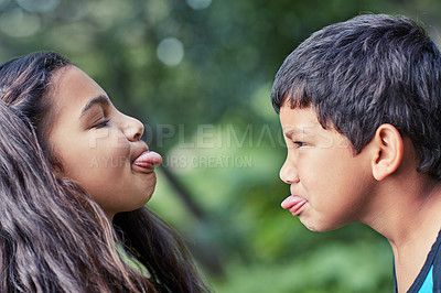 Buy stock photo Shot of a young brother and sister teasing each other while playing outside