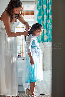 Buy stock photo Shot of a mother and her daughter playing dress up at home together